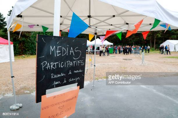 A stand for 'medias' is displayed as people gather to take part in a rally for the launching of the movement 'transpartisan et citoyen' by French...