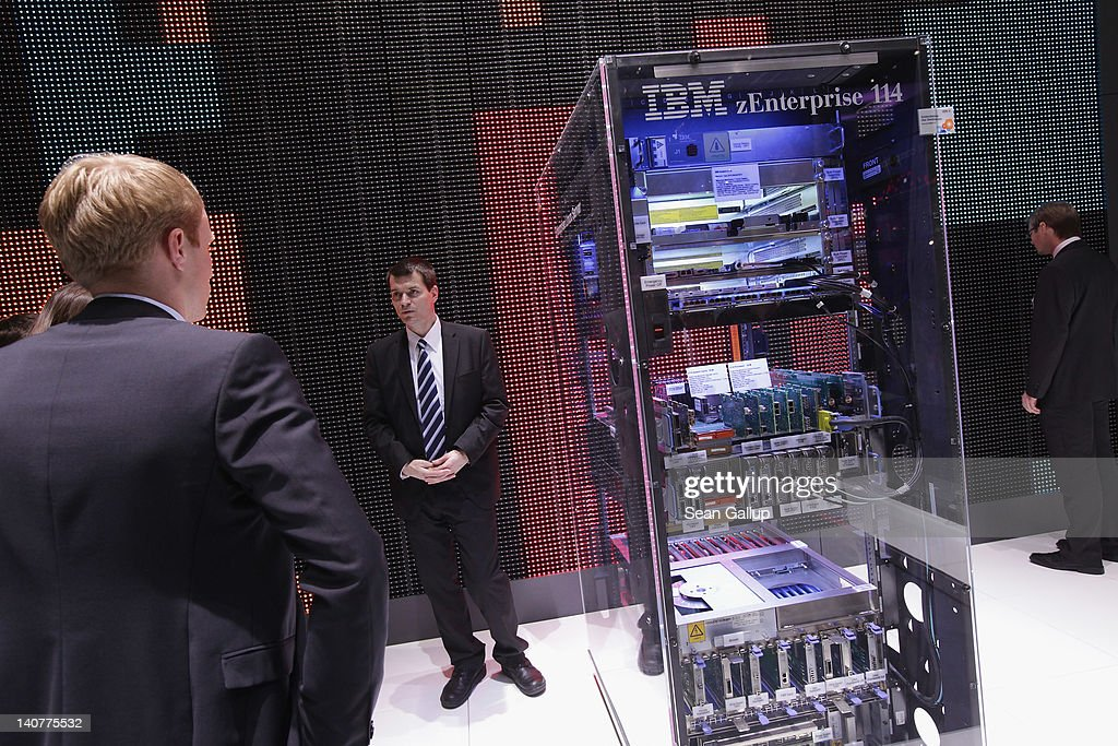 A stand host explains a zEnterprise 114 high-performance mainframe at the IBM stand on the first day of the CeBIT 2012 technology trade fair on March 6, 2012 in Hanover, Germany. CeBIT 2012, the world's largest information technology trade fair, will run from March 6-10, and advances in cloud computing and security are major features this year.