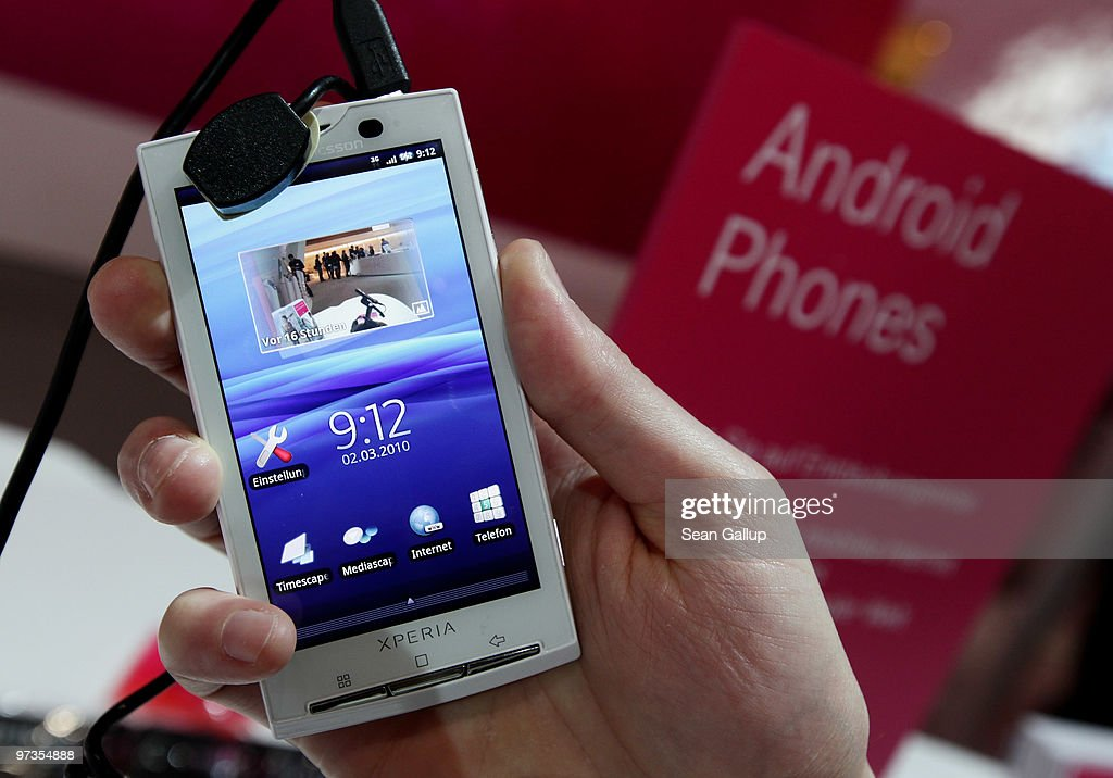 A stand host holds a Sony Ericsson XPERIA X10 mobile phone that uses the Android operating system at the Deutsche Telekom stand at the CeBIT Technology Fair on March 2, 2010 in Hannover, Germany. CeBIT will be open to the public from March 2 through March 6.