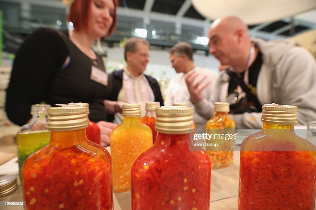 A stand hostess presents organic chili sauces at the 2013 Gruene Woche agricultural trade fair on January 18, 2013 in Berlin, Germany. The Gruene Woche, which is the world's largest agricultural trade fair, runs from January 18-27, and this year's partner country is Holland.