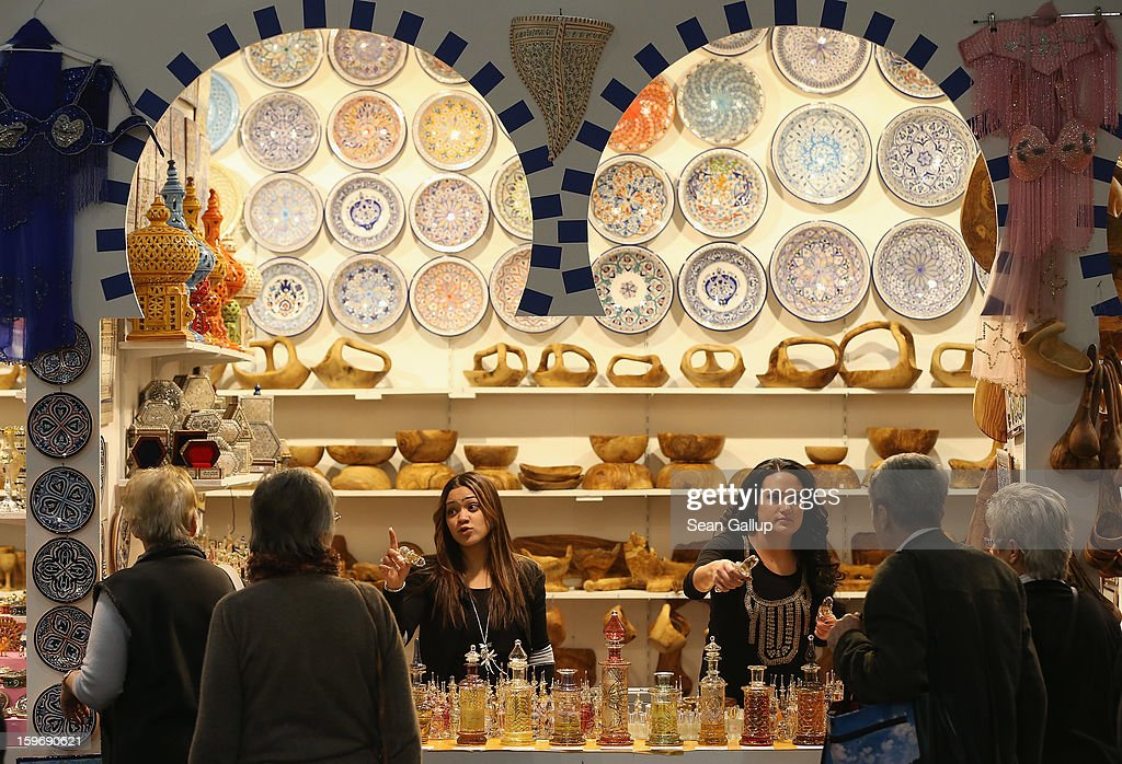 Stand hostesses sell alcohol-free perfume at a Tunisian stand at the 2013 Gruene Woche agricultural trade fair on January 18, 2013 in Berlin, Germany. The Gruene Woche, which is the world's largest agricultural trade fair, runs from January 18-27, and this year's partner country is Holland. According to a recent study the average German consumes 1094 animals in his or her lifetime, including four cows, four sheep, 12 geese, 37 ducks, 46 turkeys, 46 pigs and 945 chickens.