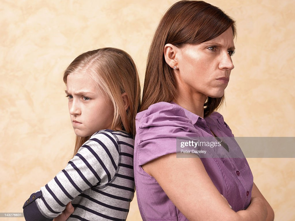 Stand off between mother and daughter : Stock Photo