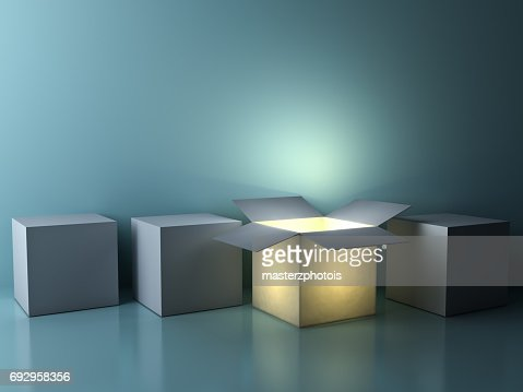 Stand out from the crowd , different creative idea concepts , One luminous opened box glowing among closed white square boxes on dark green background with reflections and shadows : Stock Photo