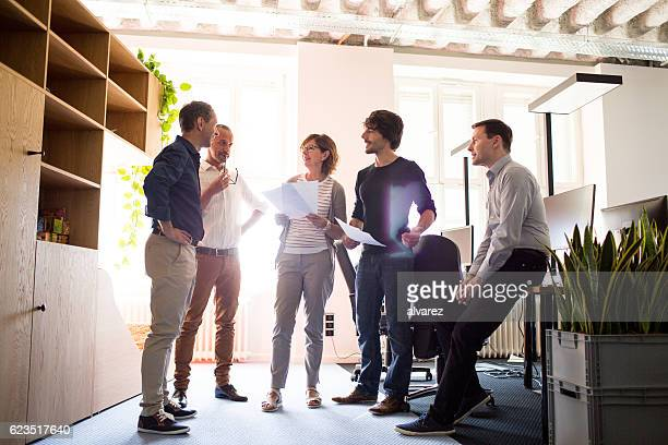 Stand up meeting of entrepreneurs in an office space