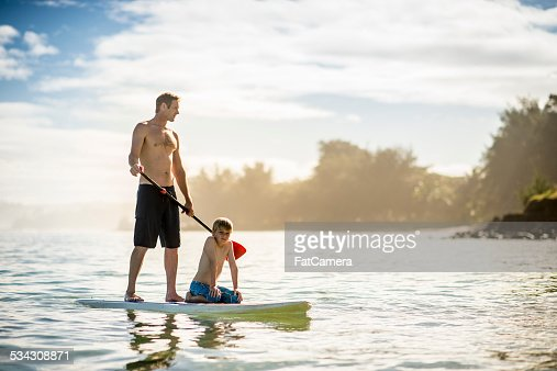 SUP Stand Up Paddle Boarding father and son