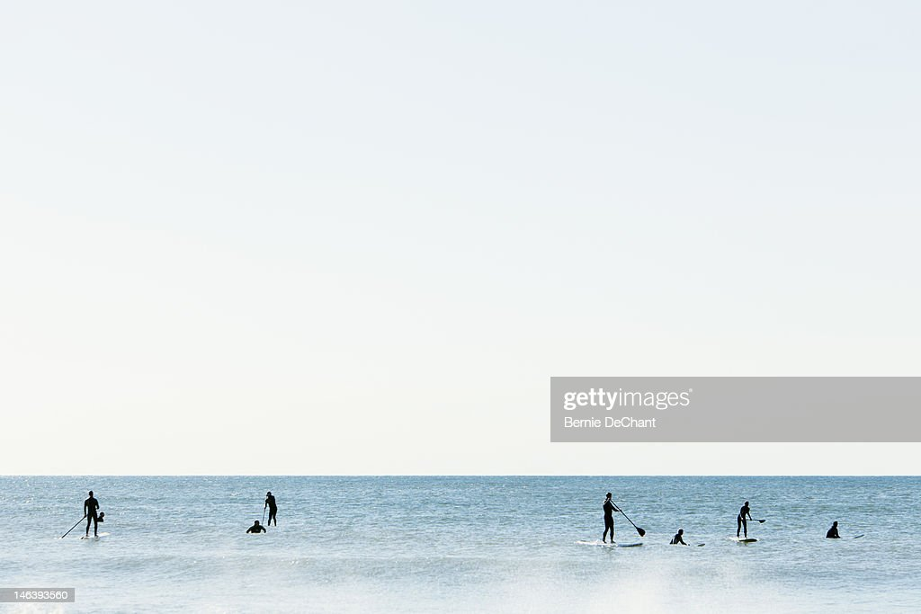 Stand up paddle surfers in Atlantic Ocean