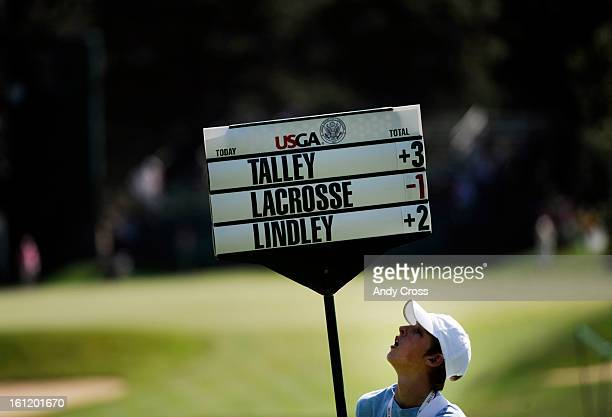 SPRINGS CO A standard bearer checks his numbers during the first round of the US Women's Open at The Broadmoor Thursday morning for golfers Emma...