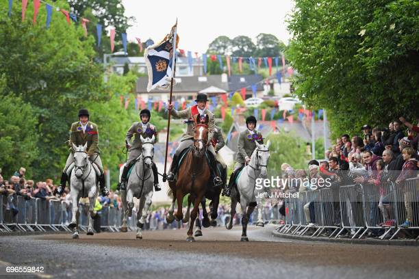 Standard bearer Kieran Riddell and his attendants arrive back in the town as they take part in the town's Common Riding one of the oldest Borders...