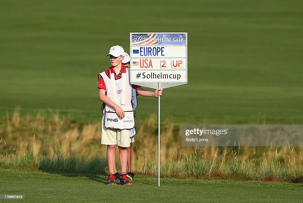 A standard bearer stands in the 16th fairway during the afternoon fourball matches at 2013 Solheim Cup at the Colorada Golf Club on August 16, 2013 in Parker, Colorado.
