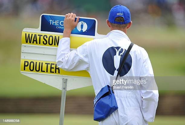 A standard bearer watches the play during the third round of the 141st Open Championship at Royal Lytham St Annes Golf Club on July 21 2012 in Lytham...