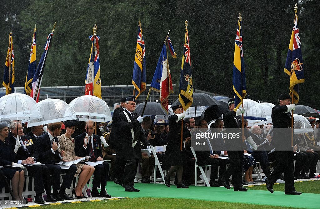 Standard bearers make their way to the monument as <a gi-track='captionPersonalityLinkClicked' href=/galleries/search?phrase=Prince+Harry&family=editorial&specificpeople=178173 ng-click='$event.stopPropagation()'>Prince Harry</a>, Catherine, Duchess of Cambridge and <a gi-track='captionPersonalityLinkClicked' href=/galleries/search?phrase=Prince+William&family=editorial&specificpeople=178205 ng-click='$event.stopPropagation()'>Prince William</a>, Duke of Cambridge shelter under umbrella during the Commemoration of the Centenary of the Battle of the Somme at the Commonwealth War Graves Commission Thiepval Memorial on July 1, 2016 in Thiepval, France. The event is part of the Commemoration of the Centenary of the Battle of the Somme at the Commonwealth War Graves Commission Thiepval Memorial in Thiepval, France, where 70,000 British and Commonwealth soldiers with no known grave are commemorated.