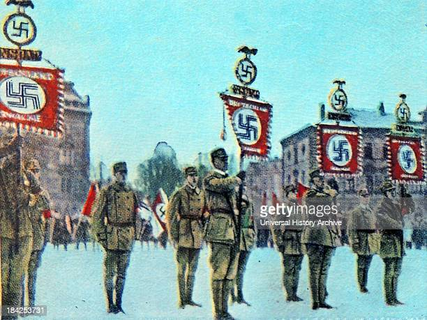 Standard bearers with Swastikas march by Nazi party members Munich 1923 Germany
