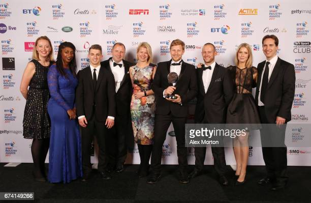 Standard Chartered Bank Inside Anfield pose with the International Marketing Campaign of the Year award in association with SMG Insight with Kadeena...