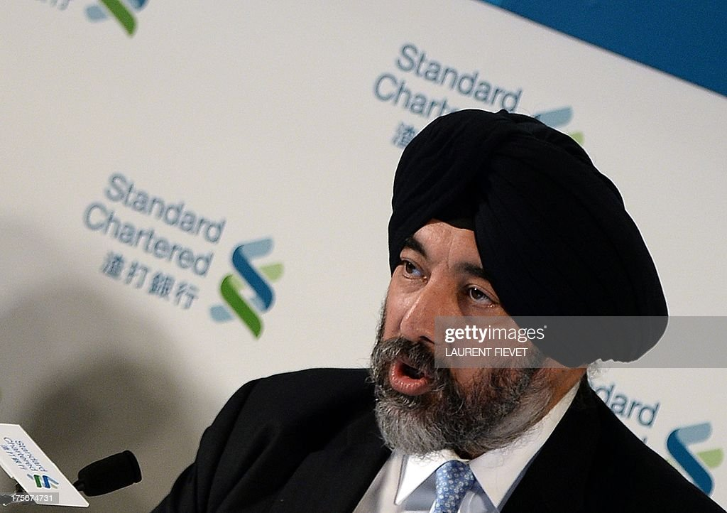 Standard Chartered group executive director and chief executive officer Asia Jaspal Bindra speaks at a press conference prior to announcing the company's half year result in Hong Kong on August 6, 2013. Standard Chartered said its first-half net profit fell 24 percent in a turbulent global economy coupled with increased regulation. AFP PHOTO / Laurent FIEVET