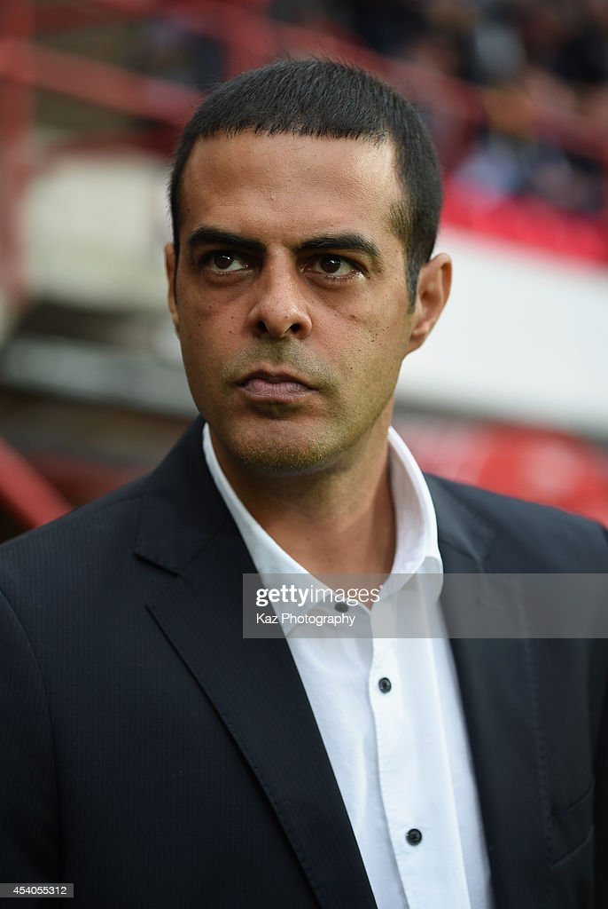 Standard de Liege head coach <a gi-track='captionPersonalityLinkClicked' href=/galleries/search?phrase=Guy+Luzon&family=editorial&specificpeople=4595259 ng-click='$event.stopPropagation()'>Guy Luzon</a> looks on during the Belgium Jupilar League match between Standard de Liege and Westerlo at Stade Maurice Dufrasne on August 23, 2014 in Liege, Belgium.