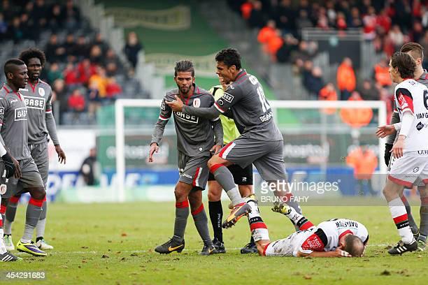 Standard de Liege's Mehdi Carcela hits OHL's Bjorn Ruytinx during the Jupiler Pro League football match between OH Leuven and Standard de Liege in...