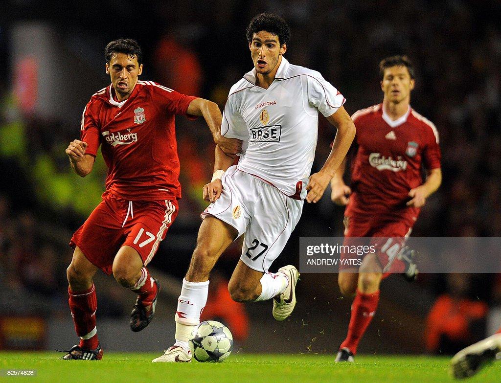 Standard Liege Belgium midfielder Marouane Fellaini vies with Liverpool's Spanish defender lvaro Arbeloa during their UEFA Champions League Third...