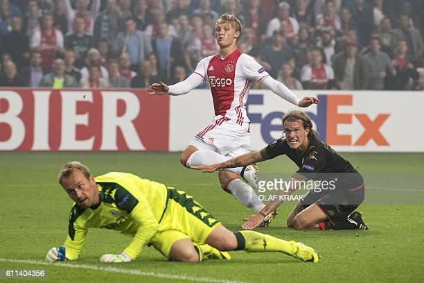 Standard Liege goalkeeper JeanFrancois Gillet and Ajax Amsterdam's Danish forward Kasper Dolberg eye the ball during the UEFA Europa League group G...