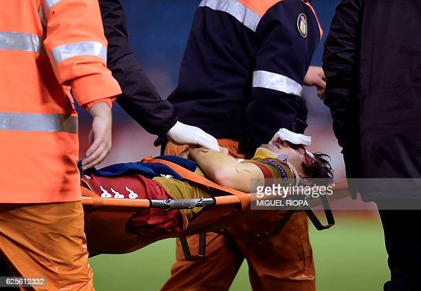 Standard Liege's forward Benito Raman is carried on a stretcher after resulting injured during the Europa League Group G football match RC Celta de...