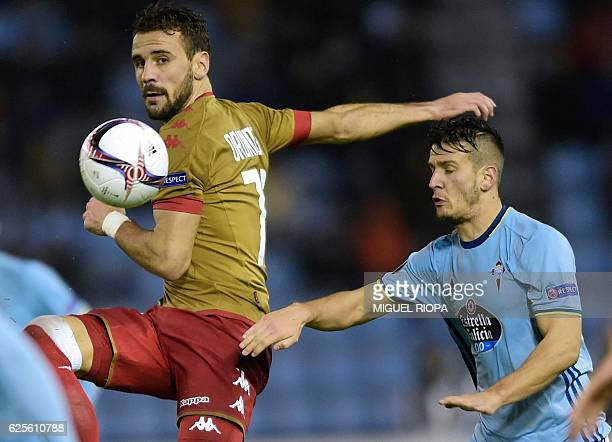 Standard Liege's Portuguese forward Orlando Sa vies with Celta Vigo's Serbian midfielder Nemanja Radoja during the Europa League Group G football...
