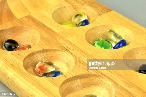 Standard Mancala game board and marbles