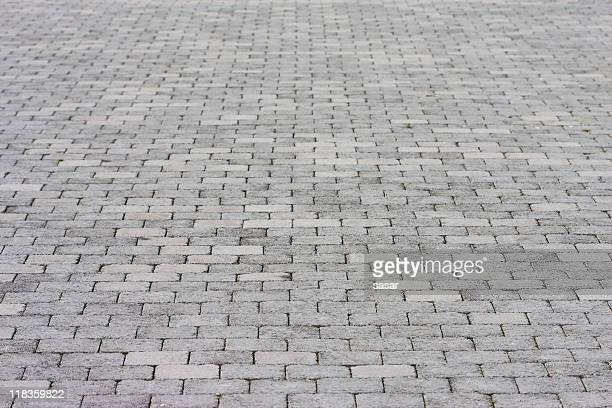 Standard pavement made up of rows of grey bricks