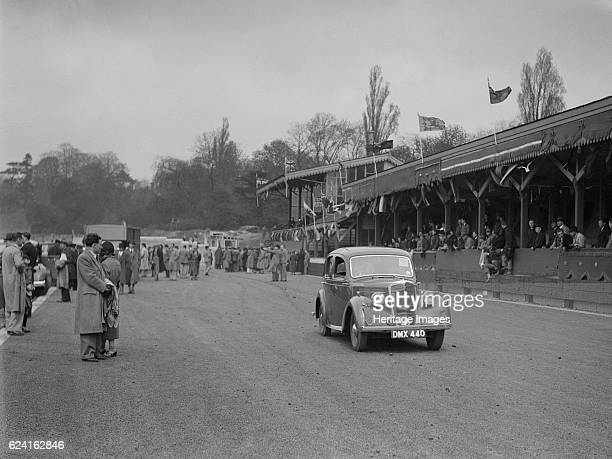 Standard saloon at a race meeting at Crystal Palace London 1939 Artist Bill BrunellStandard Saloon 1936 1608 cc Vehicle Reg No DMX440 Place Crystal...