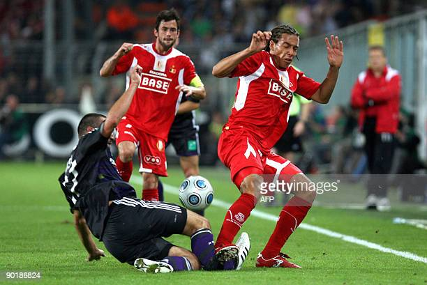 Standard's Axel Witsel gets a red card for this fault on Anderlecht's Marcin Wasilewski of Poland who left the field injured during the Belgian first...