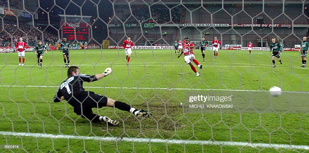 Standard's Emile Mpenza scores on penalty against Brugge's goal keeper Ricky Begeyn during the first league soccer match Standard vs Cercle Brugge...