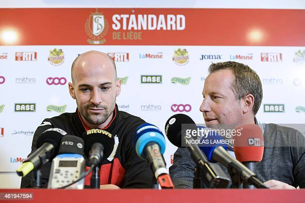 Standard's football player Laurent Ciman and Standard's vicechairman Bruno Venanzi give a press conference in Liege on January 22 2015 AFP PHOTO...