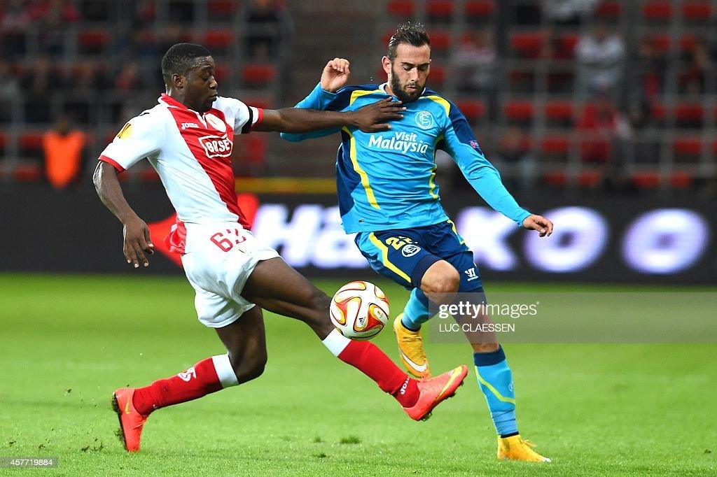 Standard's Geoffrey Mujangi Bia and Sevilla's Aleix Vidal fight for the ball during the UEFA Europa League football match Standard Liege vs Sevilla...