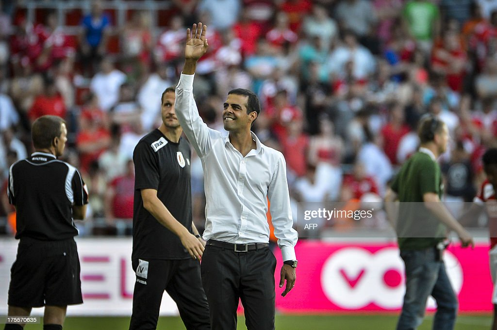 Standard's head coach Guy Luzon celebrates after winning the Jupiler Pro League match between Standard de Liege and Lierse SK, in Liege, on August 4, 2013, during the Belgian football championships.