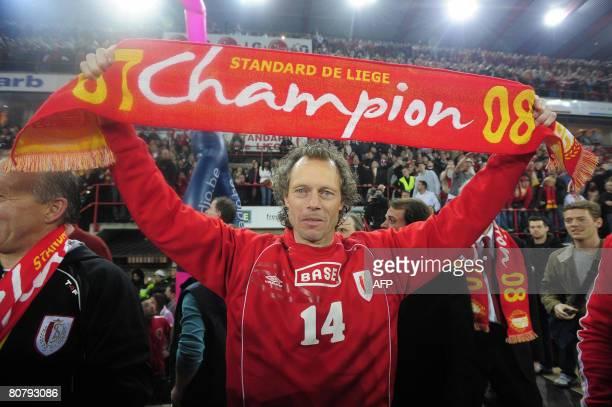 Standard's head coach Michel Preud'homme celebrates after the Belgian club Standard de Liege defeated RSCA Anderlecht on day 31 of the Jupiler League...