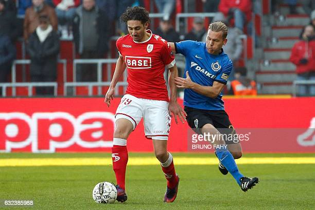 Standard's Ishak Belfodil vies with Club Brugge's Rudy Ruud Vormer during the Jupiler Pro League football match between Standard de Liege and Club...