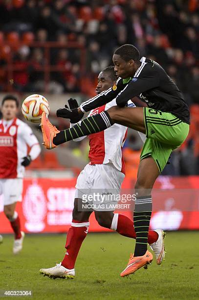 Standard's Jeff Louis vies with Feyenoord's defender Terence Kongolo during their UEFA Europa League football match Standard de Liege and Feyenoord...
