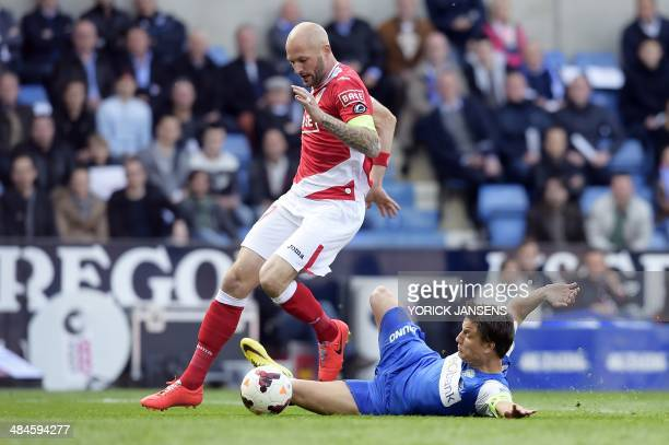 Standard's Jelle Van Damme and Genk's Jelle Vossen fight for the ball during the Jupiler Pro League match of PlayOff 1 between KRC Genk and Standard...