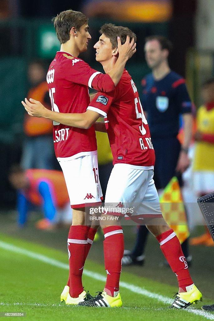 Standard's Julien De Sart and Alexis De Sart hug during the UEFA Europa League third qualifying round footbal match between Standard de Liege and FK...