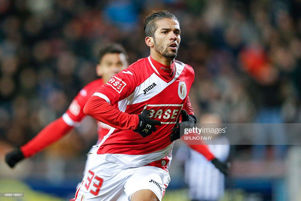 Standard's Mehdi Carcela celebrates after scoring a goal during the Belgian Jupiler Pro League football match between Sporting Charleroi and Standard de Liege, in Charleroi, on February 15, 2014.