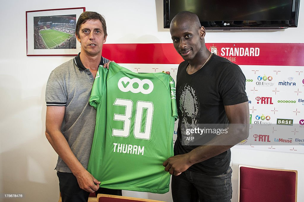 Standard's new player French Yohann Thuram poses for the photographer after a press conference of Belgian first division soccer team Standard de Liege to present a new player, on August 6, 2013 in Liege.