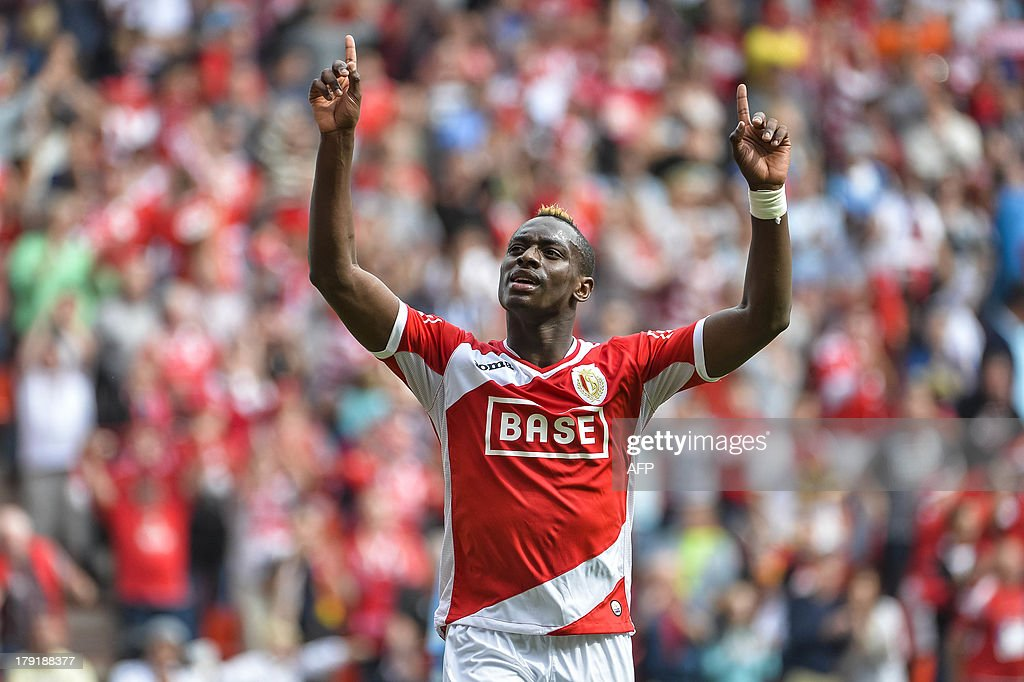 Standard's Paul-Jose Mpoku Ebunge celebrates after scoring during the Jupiler Pro League match between Standard de Liege and KV Kortrijk, in Liege, on September 1, 2013, on the sixth day of the Belgian soccer championship.