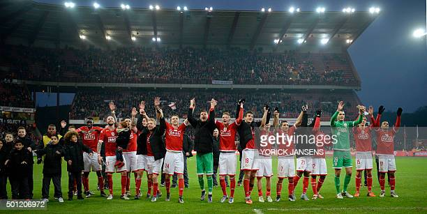 Standard's players celebrate their victory after the Jupiler Pro League match between Standard de Liege and Club Brugge in Liege on December 13 2015...