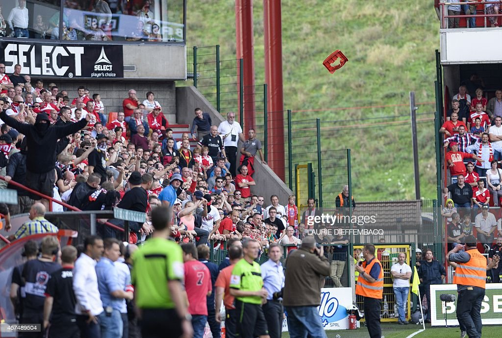 Standard's supporters riot and throw chairs on the pitch during the Jupiler Pro League match between Standard de Liege and Zulte Waregem in Liege on...