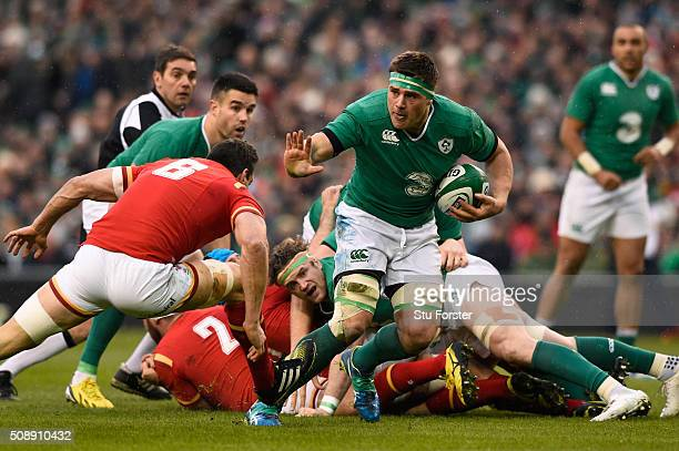 Stander of Ireland hands off Sam Warburton of Wales during the RBS Six Nations match between Ireland and Wales at the Aviva Stadium on February 7...