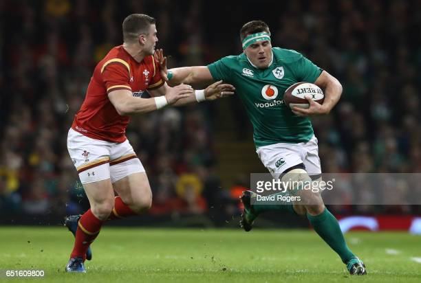 Stander of Ireland holds off Scott Williams of Wales during the Six Nations match between Wales and Ireland at the Principality Stadium on March 10...