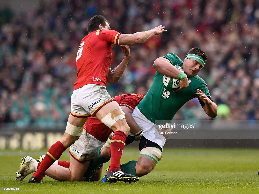 CJ Stander of Ireland is tackled by <a gi-track='captionPersonalityLinkClicked' href=/galleries/search?phrase=Sam+Warburton&family=editorial&specificpeople=4234449 ng-click='$event.stopPropagation()'>Sam Warburton</a> of Wales during the RBS Six Nations match between Ireland and Wales at the Aviva Stadium on February 7, 2016 in Dublin, Ireland.