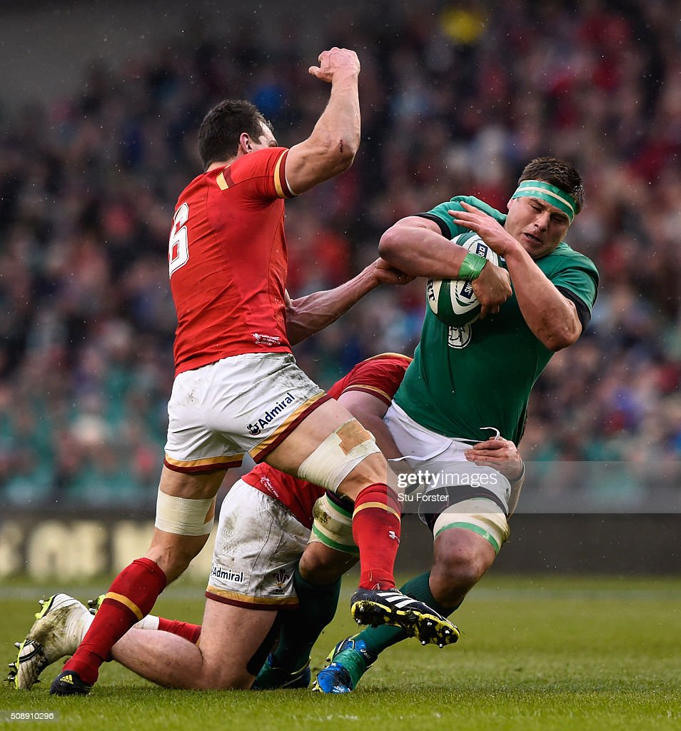 CJ Stander of Ireland is tackled by <a gi-track='captionPersonalityLinkClicked' href=/galleries/search?phrase=Sam+Warburton+-+Rugby+Player&family=editorial&specificpeople=4234449 ng-click='$event.stopPropagation()'>Sam Warburton</a> of Wales during the RBS Six Nations match between Ireland and Wales at the Aviva Stadium on February 7, 2016 in Dublin, Ireland.