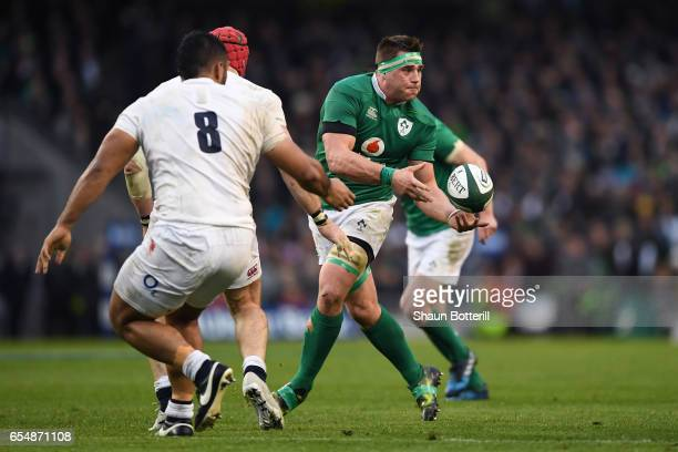 Stander of Ireland offloads during the RBS Six Nations match between Ireland and England at the Aviva Stadium on March 18 2017 in Dublin Ireland