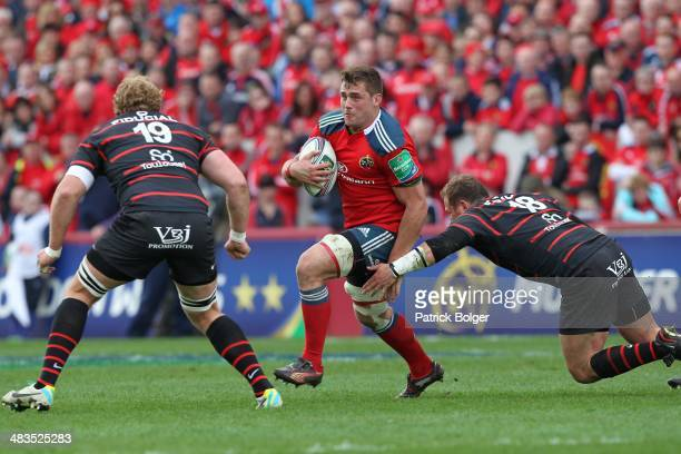 Stander of Munster and Romain MilloChluski and Schalk Ferreira of Toulouse during the Heineken Cup Quarter Final match between Munster and Toulouse...