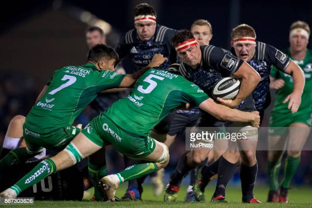 CJ Stander of Munster tackled by James Cannon and Jarrad Butler of Connacht during the Guinness PRO14 match between Connacht Rugby and Munster Rugby...