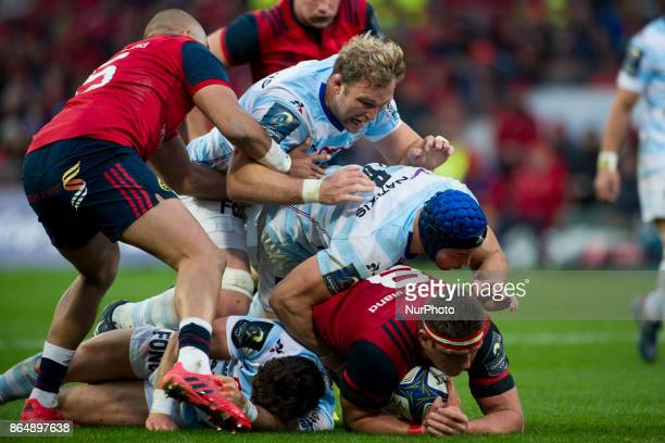CJ Stander of Munster tackled by Wenceslas Lauret of Racing 92 during the European Rugby Champions Cup Round 2 match between Munster Rugby and Racing...